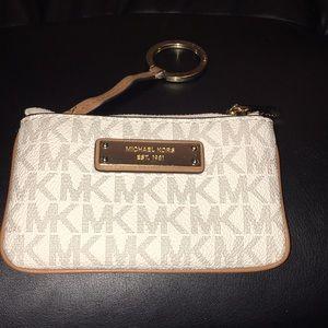 Vanilla MK keychain and change purse in gray shape